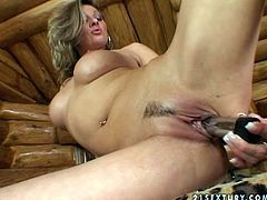 Stunning Caroline Cage poses naked by the bar counter and then toys herself with metal dildo. After that she gapes her wet pussy.