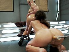 See Phoenix Marie team up with a blonde girl to go lesbian. They get all oiled up and prepare to get fucked in their pussies and asses by fucking machines.