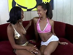 Two gorgeous black teen lesbians lick pussy and rub clits with dildos
