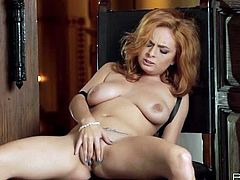Sexy redhead girl touches her nipples and then takes her clothes off. After that she sits down on a chair and finger fucks her pussy.