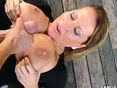 This horny and petite blond milf got some huge, hanging natural tits. She gives this dude a nice blowjob and then rides his huge cock.