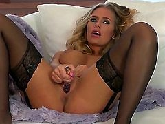 Get relish with delicious juicy blonde chick Nicole Aniston in nice black stockings. This horny sexy slut has big boobs and pretty trimmed pussy and she knows how to tease and masturbate with her lovely dildo