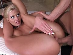 Sexy busty blonde Phoenix Marie drives some guy crazy with a perfect blowjob. Then she puts her legs behind her neck and lets him drill her smooth pussy and tight butt.