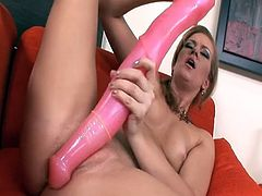 Huge pink toy in her pussy