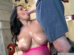 Busty slut sucks on a cock