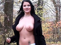 Outdoor scene with a horny brunette Adrianne Black who masturbates in the forest