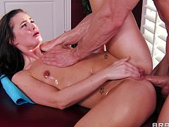 Lily Carter wa enjoying a full body massage with lots of oil before her dirty masseur began to tease her pussy and eventually crack her butt hole open.