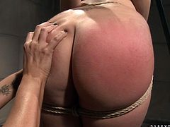 This is a real hot lesbian fetish scene with a sexy brunette babe Mandy and her slave Naomie. She ties Naomie up and makes her feel hot.