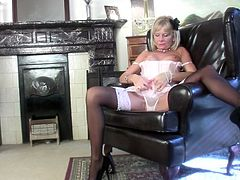 A dirty phone conversation was all Cathy needed to get horny. The stylish blonde mature puts down the phone and begins rubbing her nipples before spreading those sexy thighs to masturbate. Watch her taking of those white panties and lustfully rubbing her cunt. What a whore, she really needs a hard cock!