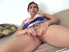 She's solo, horny and has a tight pussy! Meet the redhead bitch Lidia and see how she li