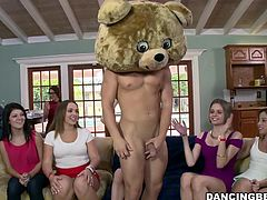 This stripper is dressed in a bear costume. He's wearing nothing but the head of the bear costume while he waves his cock all over the place. They many women at this party take turns sucking his large cock.