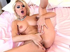 Sweet blonde Jasmine Rouge is licking her fingers