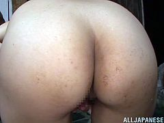 Big-breasted Japanese girl is playing with her body and lets two dudes watch her. The men watch the hottie rubbing her pussy and jerk their dicks off.
