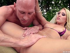 Cock-swallowing blonde AJ Applegate being impaled by Johnny Sins right in the swimming pool