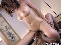 Busty Japanese milf is having fun with some guy indoors. They caress each other and then fuck doggy style and in other positions.
