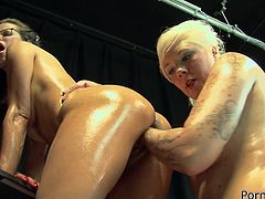 These cunts like fisting more then anything and they know how to do it right. They are completely naked and oil themselves to be nice and slippery. The blonde starts using her fisting skills and gives her girlfriend a mean, deep pussy fisting making her moan and stretching that sweet cunt.