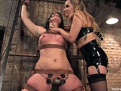 Salacious brunette Raina Verene is having fun with Lobo and some girl. She lets them tie her up and then they do all what they want with her tits and holes.