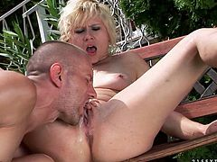 Slutty blonde milf Chicky Clarissa has fun with a guy outdoors. She sucks his dick and then they bang in side-by-side position.