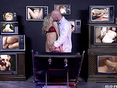 Jessa Rhodes is getting a mental evaluation at the psychiatrist's office. She is made to watch porn on many television screens to see if she is sane. she gets horny and the blonde babe fucks the doc right then and there.