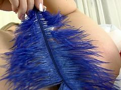 Watch as she seductively teases you the viewer by slowly rubbing a blue feather all over her pretty body. She rubs it against her clit for a tingling sensation the she sticks her fingers deep inside her pussy.