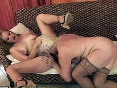 Damn it! What a nasty lesbian sex scene this is! This old lady gets naked with a super sexy blond honey Mylen and eats her wet twat.