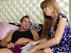 Spoiled red-haired mom hooks up with muscular young dude. She strokes his penis gently with his hand before he starts sucking her ovesized tits. Later she inclines to mouth fuck his long stiff penis in steamy sex clip by Naughty America.
