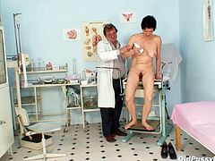 Insatiable doctor fills a stretched hairy pussy of fuckable granny with a gallon of medicine before he examines her pussy with gynecological speculum.