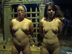 Watch these two ladies being tied up and forced to play with one another by their master before being tortured.
