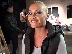 Kathia Nobili is one really beautiful blond-haired pornstar that gives interview behind the scene. Backstage scene shows that she does it with desire for the camera. She is good at it.