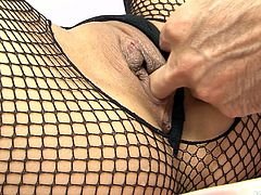 Japanese bombshell in sultry fishnet bodystocking gets her brown labia teased through a hole in her outfit before she kneels down in front of stiff rod for mouth fucking it with pleasure.