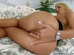 Young turned on glamorous blonde babe with natural boobies and long legs in black dress and high heels fingers her wet tight cunny to warm orgasm in arousing solo action