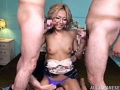 Kinky Japanese bitch with dyed hair Julia Tachibana is playing dirty games with two men indoors. She shows them her cock-sucking skills and then welcomes their pricks in her throbbing wet cunt.