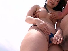 Torrid and sexy Japanese brunette needs neither swimming in the ocean nor sunbathing. Being too addicted to cum whorable and kawaii slim chick with sweet tits seduces a man and bows above his cock for giving a stout blowjob right on the beach.