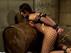 Maria Bellucci wearing a fishnet bodystocking is having fun with Mandy Bright. Mandy ties Maria up and pounds her throbbing snatch with a dildo.