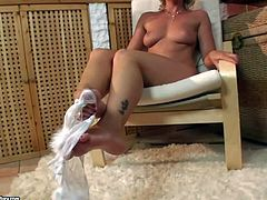 Round ass blonde Kathia Nobili takes off her panties and stockings