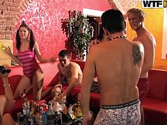 Aroused and drunk college students party hard in sauna. They bare they tasty bodies and remain in sultry lingerie and trunks before coition in group sex orgy.