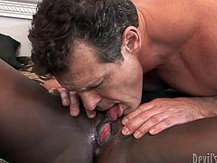 Horn made black hussy gives a zealous blowjob to kinky white daddy before he pays her back with a zealous tongue fuck in pose 69 in steamy interracial sex video by Fame Digital.