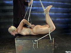 Tied up blonde chick gets blindfolded and gagged. After that she gets toyed with a vibrator and hit by electricity.