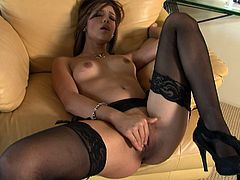Incredibly hot and sexy brunette with natural tits wears black lingerie and stockings. Torrid girlie is rather slim and flexible. This amazing chick stretches legs and opens her wet pussy, which must be fingerfucked right away for gaining delight.