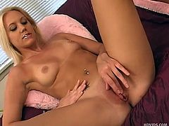 She's blonde, hot and masturbates with a smile on that pretty face. Meet our sensual babe Kacey, a lustful whore that enjoys sliding a big dildo in her pink pussy. Kacey takes off her panties after rubbing her pussy and then spreads those long sexy legs really wide, offering us the best view to her cunt
