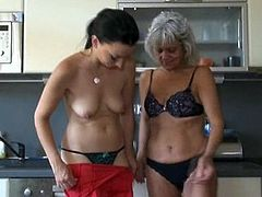 Aged blonde together with dirty knockers has her bearded clam eaten by black haired beauty