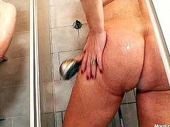 Two peppering grannies throw a wild lesbian sex orgy at the shower. They tease their ruined vaginas using shower head before one of them pours cream on quaggy tits of another hussy to lick it off with pleasure.