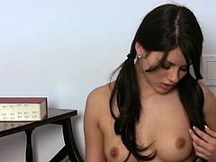 Busty brunette Shyla Jennings fondles her nice tits and rubs her pussy