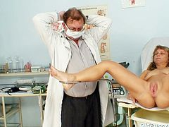 Pervert doctor uses a gynecological speculum to widen a ruined shaved pussy of rapacious blond granny in order to examine it thoroughly in steamy sex clip by Old Pussy Exam.