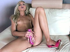 Fantastic and elegant blonde Franziska Facella starts with caressing her amazing body. When her twat becomes really wet, hottie takes off her bra and panties, spreads her legs and starts to play with her pussy using her toy.