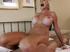 Blonde model Puma Swede with long legs and fake huge boobs is hopping on a solid prick like crazy. This sex scene is filmed by Naughty America.