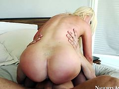 Bootyful blond milf in seductive black stockings gives a rapacious cowgirl ride to aroused fucker before she turns around to continue riding him in reverse cowgirl style remembering to give him face sitting in the interim.