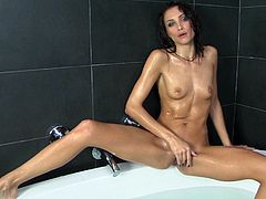 She is bathing in warm bath tub relaxing. She slips her hand in between her thighs pleasuring her pussy. Then she goes more intensive fingering her snatch.