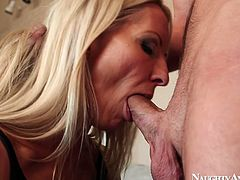 This slutty housewife knows how to please a man. Voracious and horny chick with nice boobs starts with giving a stout blowjob for cum. Then kinky hooker pulls up her black tight dress to be fucked missionary on the couch.