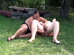 Tracy and Abigel are outdoors getting in touch with nature and each others cunts. The lustful big beautiful women are about to give us a nice show so don't miss it. First Tracy gropes her friends boobs and then slowly fingers her shaved pussy. Curious what else she will do to that fat cunt? Stay tuned and find out
